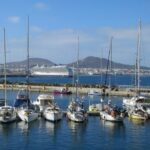 Photo: Row of sailboats along a harbour.
