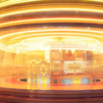 Photo: Spinning carousel with lights swirling to represent the fast pace of buying and selling of a property trader.